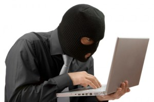 A Black-masked Hacker Breaking into a Computer