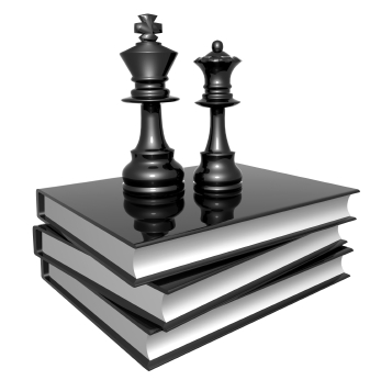 Photo of king and queen chess pieces on a stack of book.