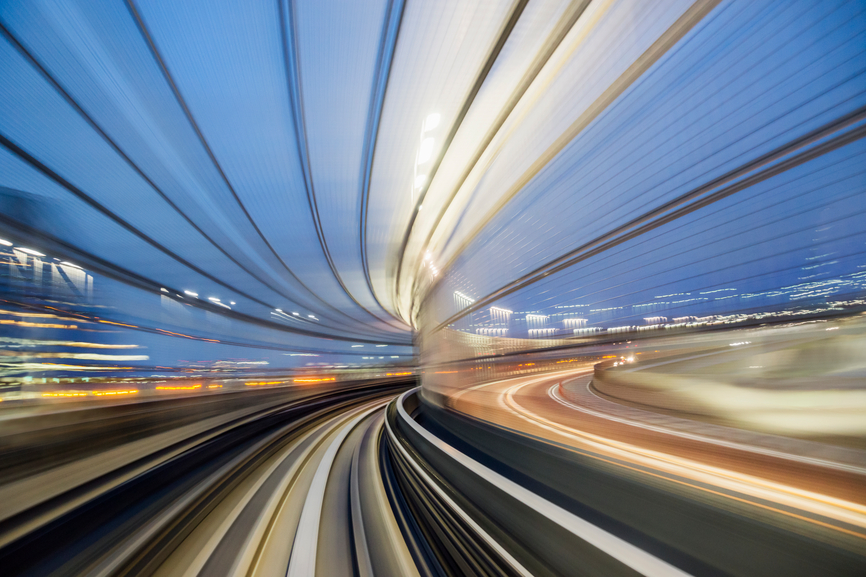 A time-lapse photo suggesting speed with curved lines of light.