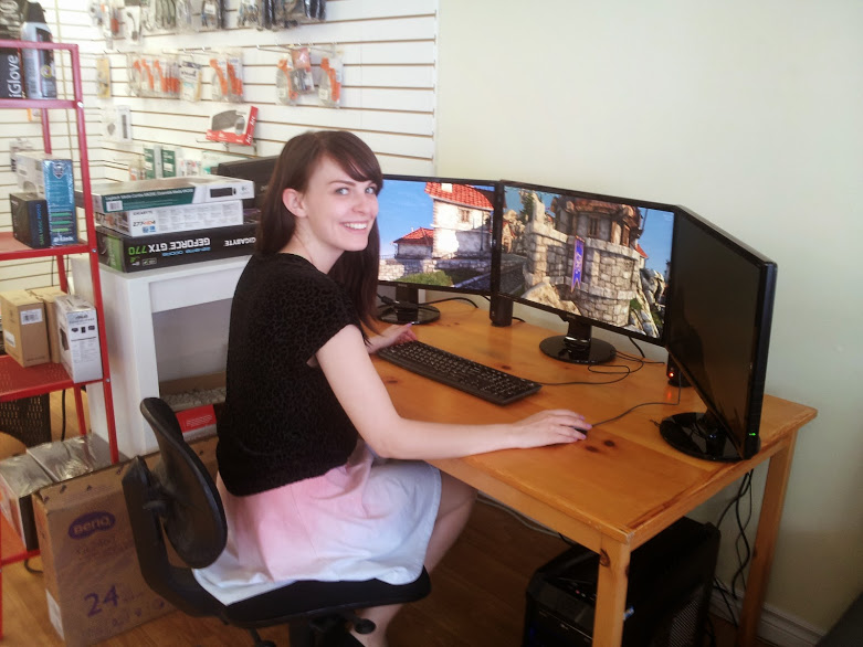 Here is Caitlin trying out our new custom-built gaming machine.