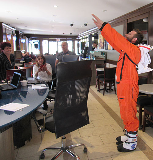 BitNATIONAL owner Jeff shows how bitcoin will take off but wearing an orange Nasa suit.