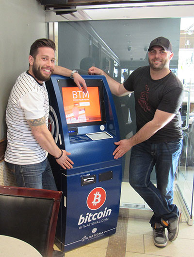 Jason and Matt standing by their BTM machine.