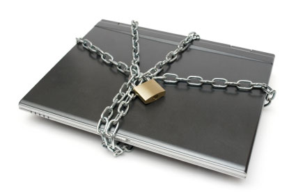 Photo of a laptop with chain and padlock symbolizing laptop virus.