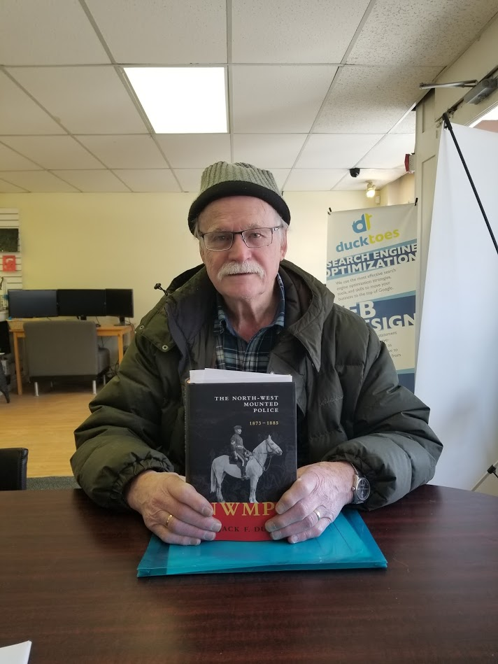 Author jack Dunn holds a copy of his new book.