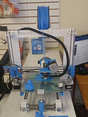 A 3-D printer at Ducktoes Computer Repair.